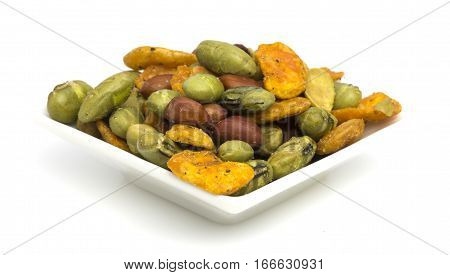 Healthy Snack of edamame beans chilli broad beans and redskin peanuts on a white background.