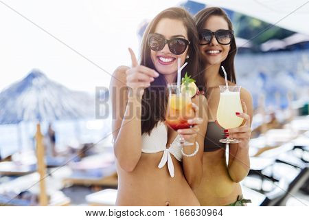 Girls Drinking Cocktails On Beach