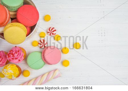 Candy Bar With Colorful Candy, Cupcakes And Macaroons
