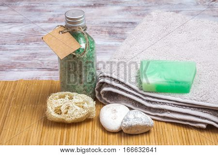 Spa Accessories On Bamboo Mat: Soap, Bath Salts, Loofah
