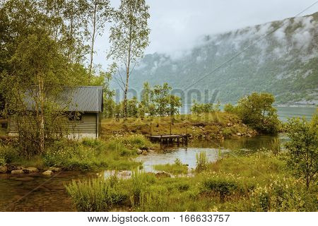 fishing lodge on Hardangerfjord fjord, south Norway