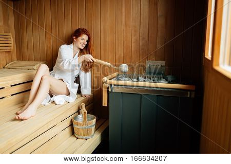 Beautiful Woman Relaxing In Finnish Sauna
