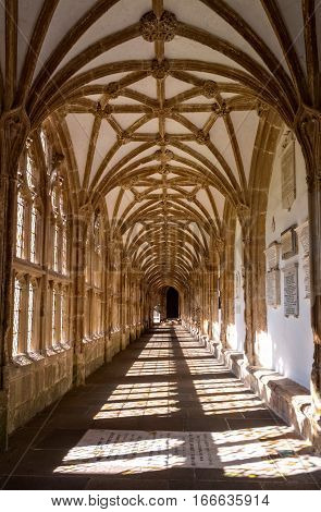 Wells United Kingdom - August 6 2016: View along cloister of Wells cathedral with lierne vault.
