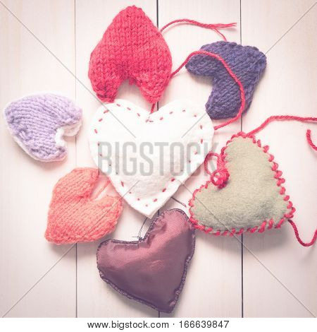 Valentine's Day. Colorful knitted hearts. Valentines day. Heart pendant. Red heart. Handmade Hearts. Valentine cards. Space for text. Toned image.