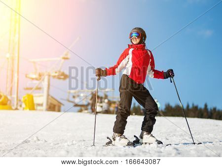 Woman With Skis On Mountain Top At A Winter Resort