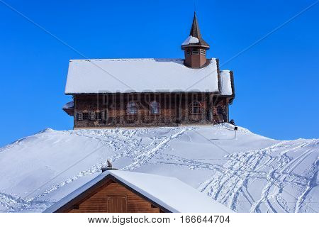 Stoos, Switzerland - 24 January, 2017: wooden chapel covered by snow. Stoos is a village located in the municipality of Morschach in the Swiss canton of Schwyz. It lies at 1300 meters above sea level and has a population of about 100 inhabitants.