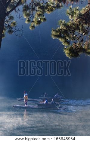 MAE HONG SON THAILAND - JANUARY 24 : traveler sailing bamboo rafing in pang ung water reservoir most popular winter traveling destination on january 24 2017 in mae hong son thailand