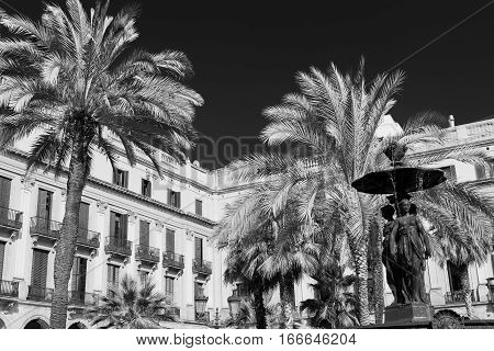 Barcelona (Catalunya Spain): Plaza Real (Placa Reial Royal Square) near the ramblas. Black and white