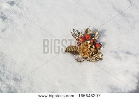 Decorative handiwork is lying on the snow. Minimalistic image.