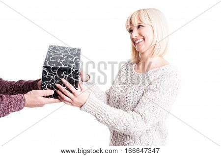 Pretty Female Wearing Warm Sweater Receiving A Present