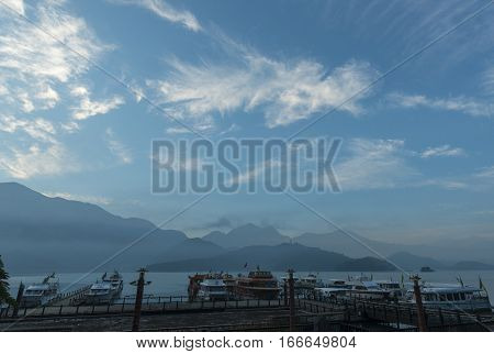 Nantou Taiwan - November 02 2016 : Tourist boats docking in peachful morning at Shuishe Pier Sun Moon Lake Taiwan.