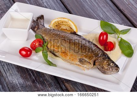 fried trout with mashed potatoes on plate