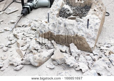 Breaking concrete with drill ,power tool, hammer