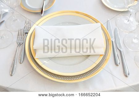 white plate yellow canvas tablecloth napkin serviette fork
