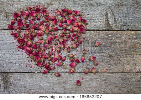 Heart Made Of Dried Flowers Roses On Wooden Table.