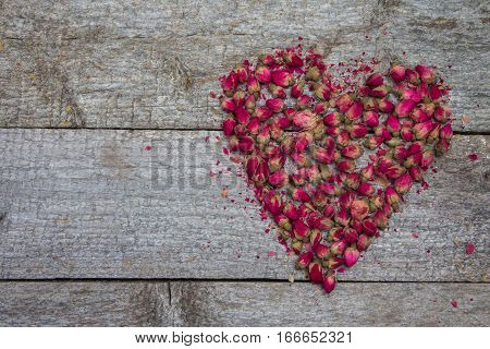 Rustic Wooden Background And Pink Heart Made Of Flowers Roses