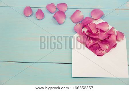 Blank white post cards, empty postcard, postcrossing, love letter. Still life, top view, copy space. Unusual creative holiday greeting card. envelope mail with roses, flat lay