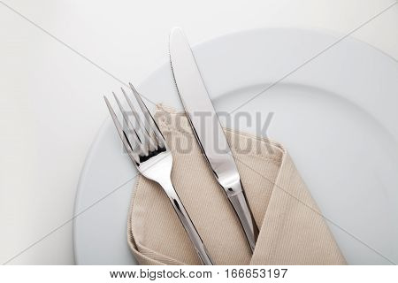 Table Setting with Plate, Fork, Knife and Napkin