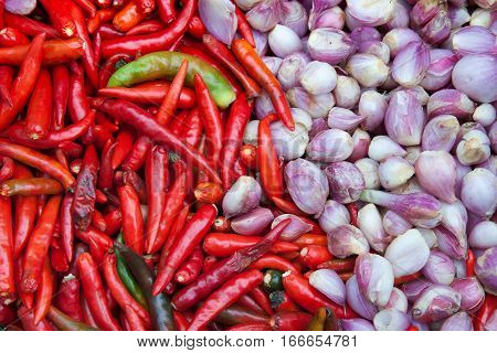 The red chilli and pink onion background