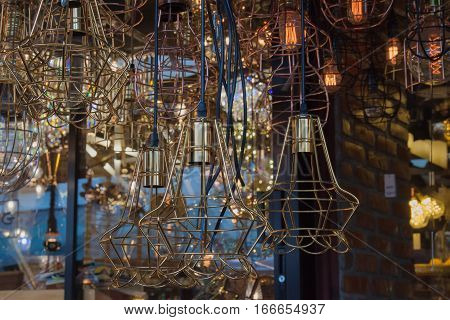 The background of lighting from many brass chandelier