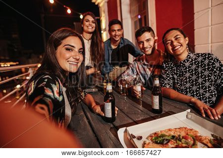 Young People Taking Self Portrait At Party