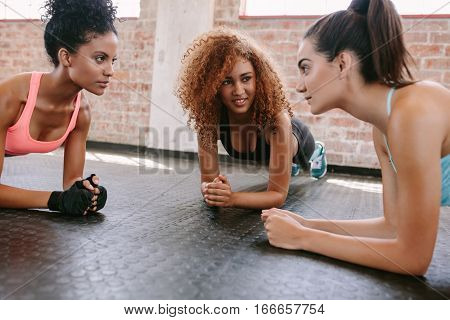 Three Young Women Doing Pushups