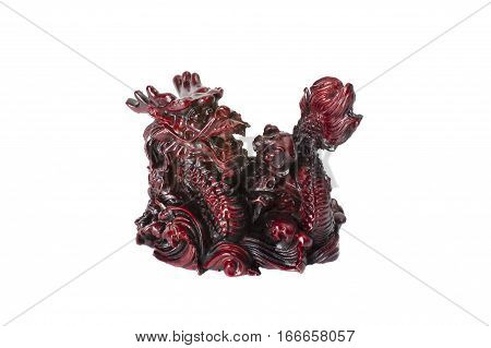 Brown traditional chinese dragon with pearl isolated on white background. Feng Shui statuette.