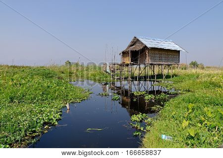 Traditional Wooden Houses At The Inle Lake