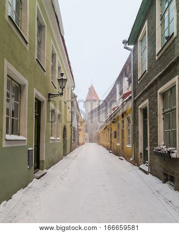 TALLINN ESTONIA - 5TH JAN 2017: A view along Muurivahe street in Tallinn during the day in the winter. Towers and part of the Old Town Wall can be seen.