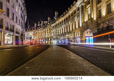LONDON UK - 8TH MARCH 2015: Regent Street in central London at night showing the architecture and outside of buildings.