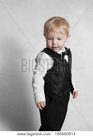 Happy baby boy. Little boy in a white shirt and bow tie. Children portrait. Stylish man in fashionable a bow-tie. Isolated with clipping path.