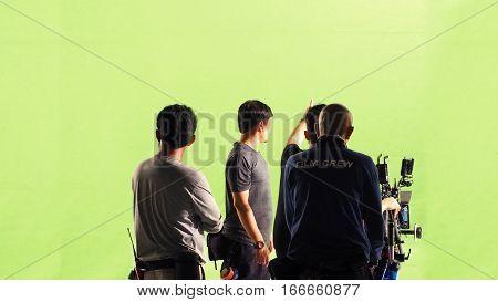 Photographer Team And Film Crew And Movie Camera.
