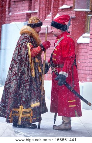 Male Russians in Traditional Costumes Walking in the Street