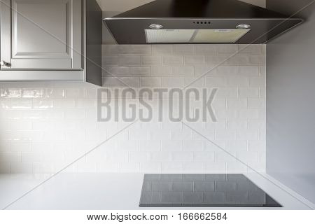 Kitchen With White Brick Tiles