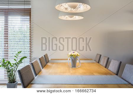 Wooden Dining Table And Lamp