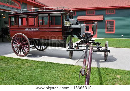 MACKINAC ISLAND, MI - JULY, 2016: An antique passenger carriage from The Grand Hotel is parked outside the carriage museum.