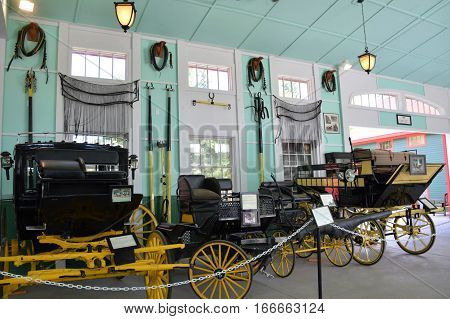 MACKINAC ISLAND, MI - JULY 2016: An interior view of the antique carriage museum on the island.