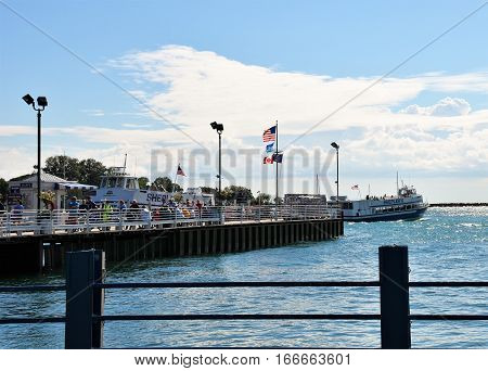 MACKINAC ISLAND, MI - JULY 2016: Tourists arrive on Mackinac Island by ferry from the mainland.
