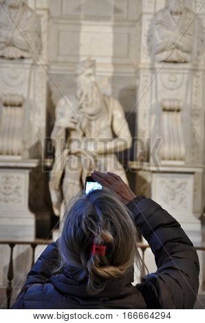 Woman Photographing The Statue Of Moses By Michelangelo