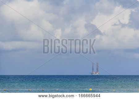 View of oil drilling platform seen from shore