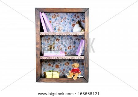 old vintage antique bookshelf isolated on white. small bookshelf with books and cute figurines