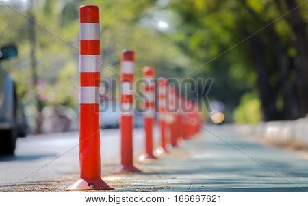 Orange traffic reflective bollards . . .