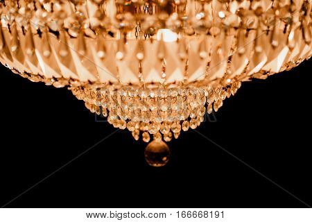 close-up Chrystal chandelier. black background with copy space.