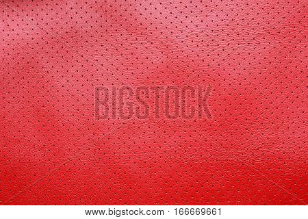 Red perforated leather texture background skin dots