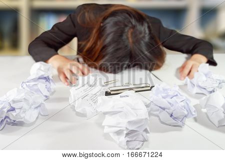 Stressed business woman make a mistake with chewed resume paper