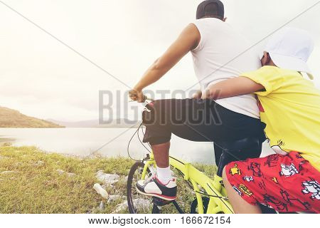 Family ride a bicycle or father and son are happy  for travel.