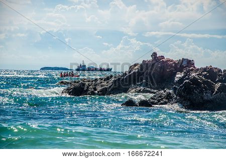 sandy beach near the blue sea. sandy beach by the blue ocean. golden sand on the shores of the ocean. Ocean waves breaking on the rocks on the shore.