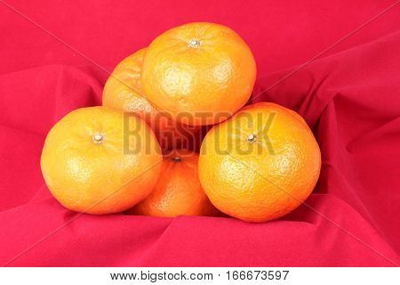 Golden Orange On Red Background, To Celebrate For Chinese Festival.