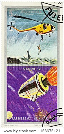 MOSCOW RUSSIA - January 25 2017: A stamp printed in Fujeira shows spacecraft Gemini 12 and helicopter series