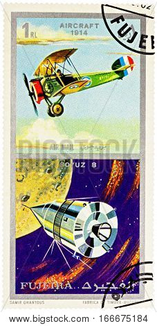 MOSCOW RUSSIA - January 25 2017: A stamp printed in Fujeira shows Russian spacecraft Soyuz 8 and ancient aircraft (1914) series
